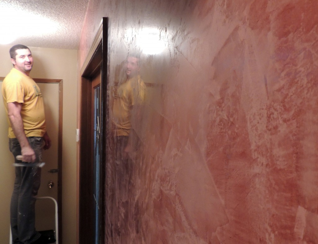 Bogdan Iles puts the finishing touches on a new Venetian plaster wall